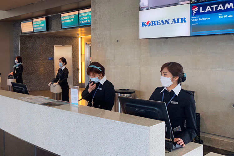 Korean Air employees are seen at Los Angeles International Airport (LAX) wearing masks, to prevent the coronavirus infection,COVID-19 on February 12.