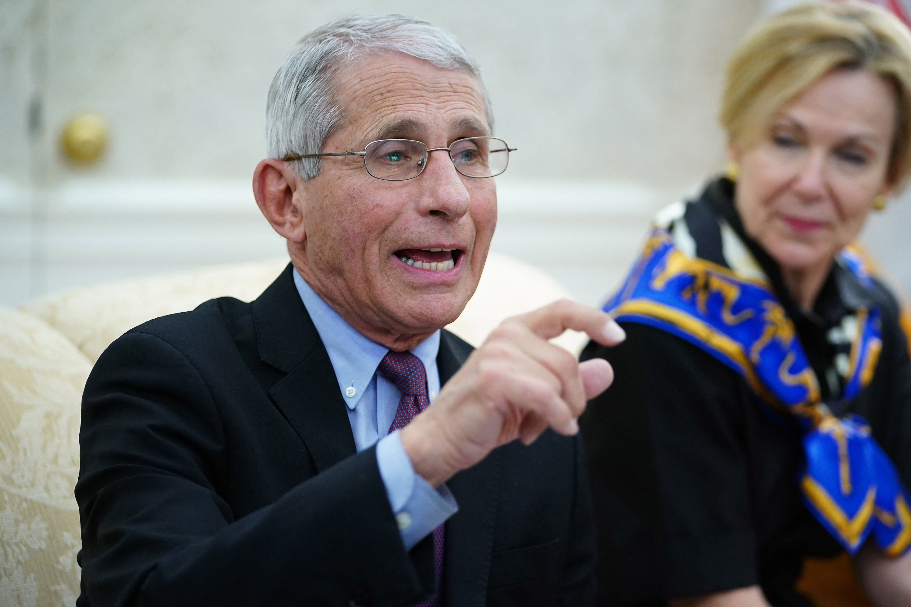 Dr. Anthony Fauci, left, director of the National Institute of Allergy and Infectious Diseases speaks during a meeting in the Oval Office of the White House in Washington on April 29.