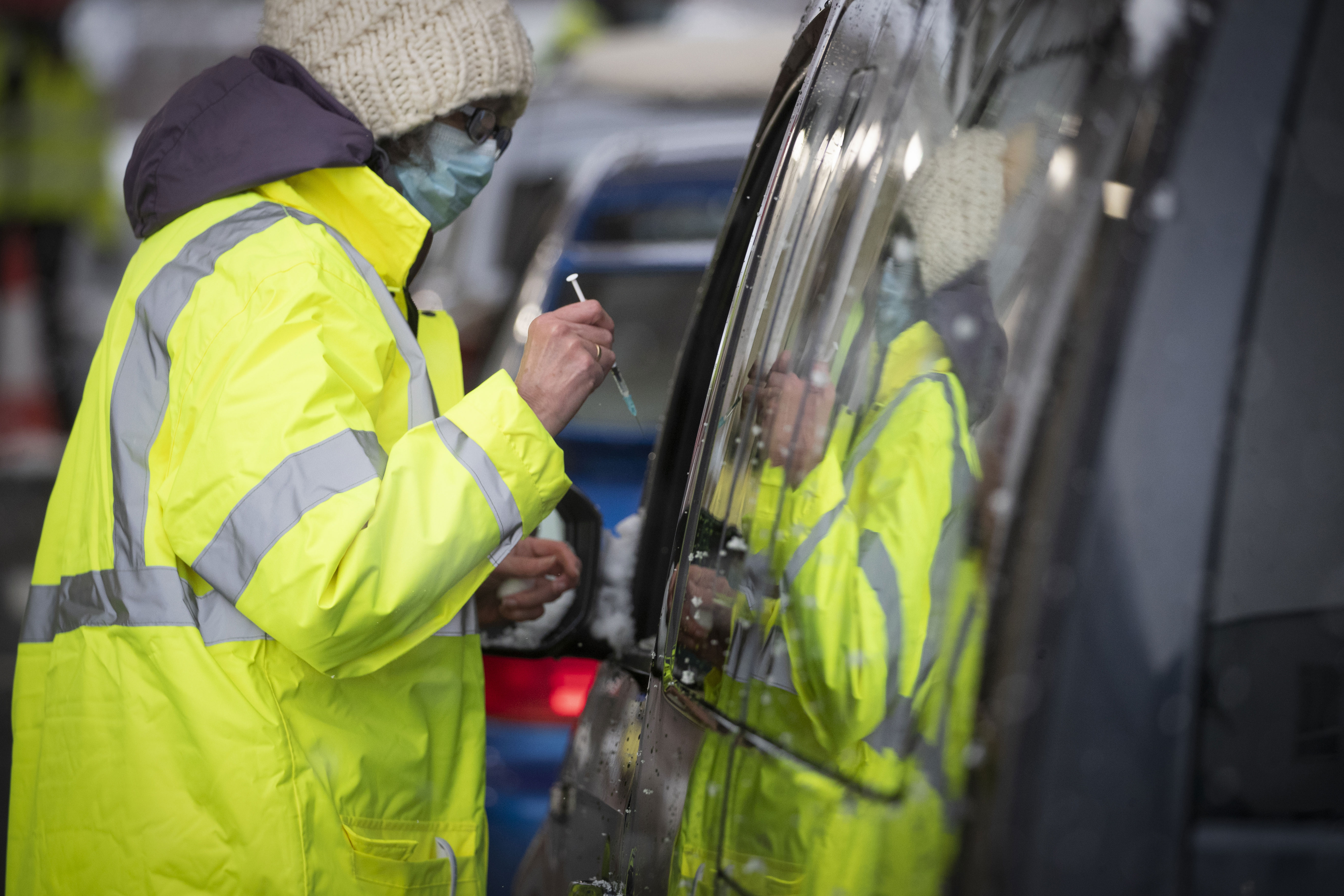 A vaccination team member works at a drive-thru Covid-19 vaccination center in Musselburgh, Scotland, on February 10.