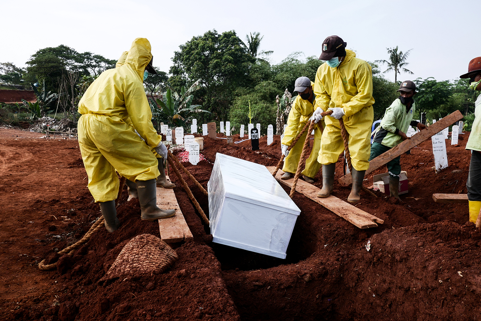 Funeral workers wearing protective suits bury a Covid-19 victim at Pondok Ranggon cemetery in Jakarta, Indonesia, on September 9.