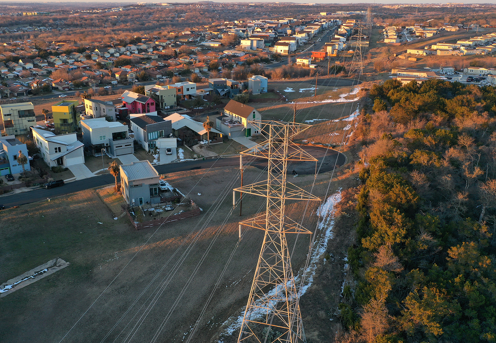 An aerial view from a drone shows electrical lines running through a neighborhood on February 19, in Austin, Texas.