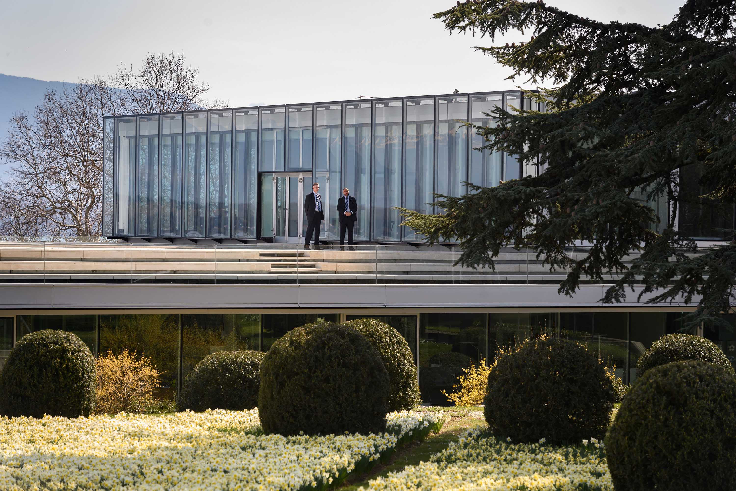 Security guards stands outside the UEFA headquarters in Nyon, Switzerland, during an emergency meeting on March 17.
