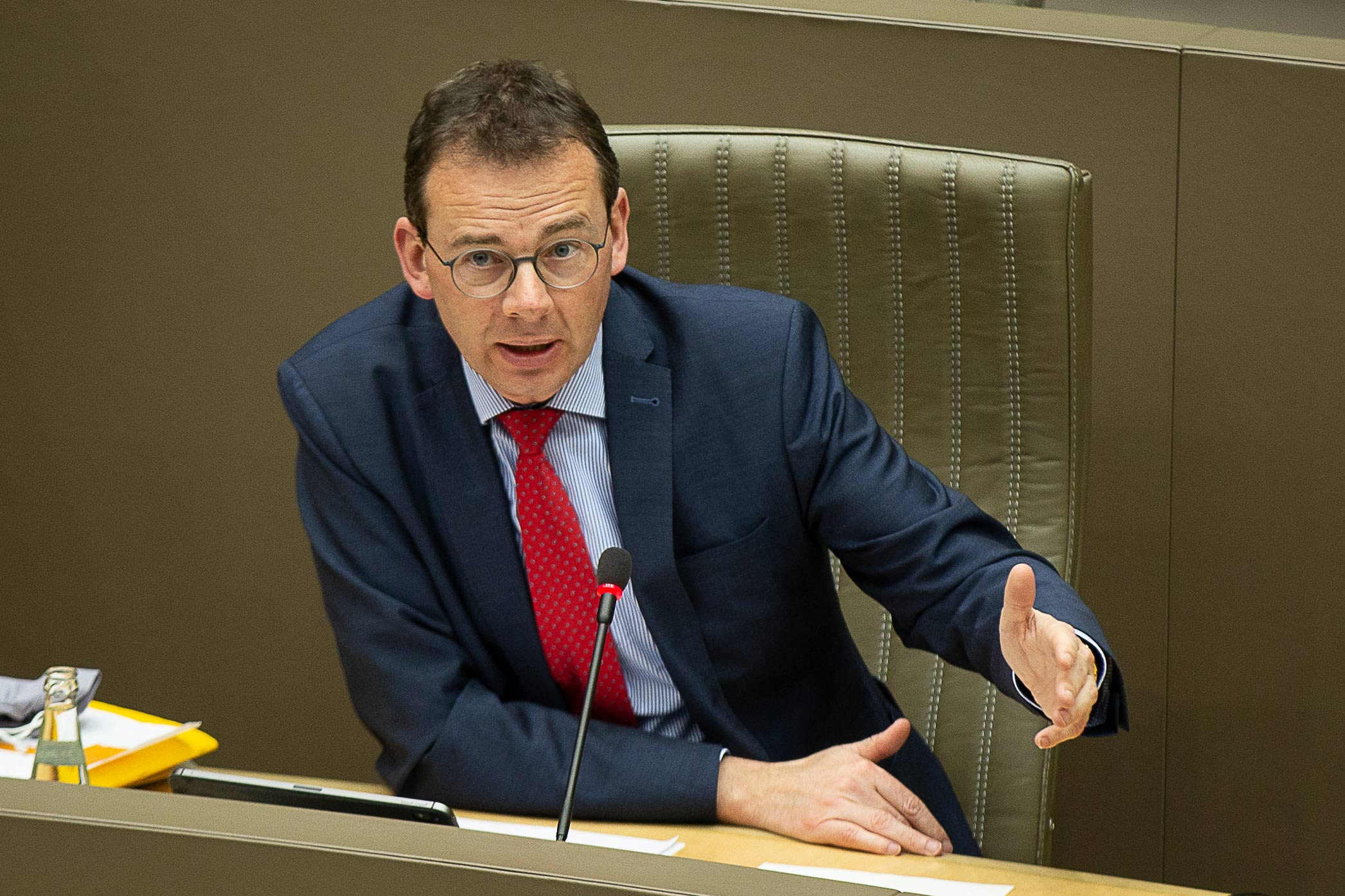 Belgian regional Health Minister Wouter Beke speaks during a meeting of the Flemish Parliament in Brussels on February 24.
