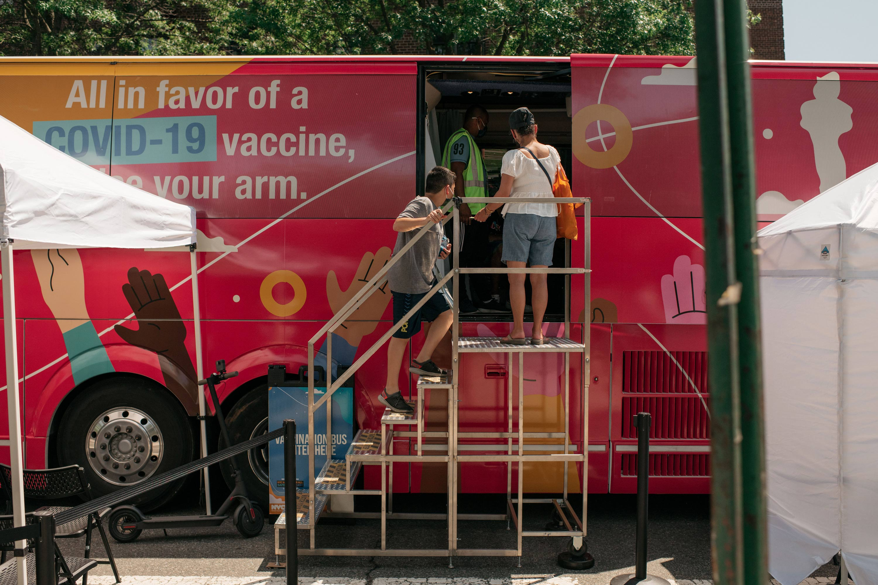 A family enters a pop-up COVID-19 vaccine site and block party on June 5,  in the Jackson Heights neighborhood in the Queens borough in New York City.
