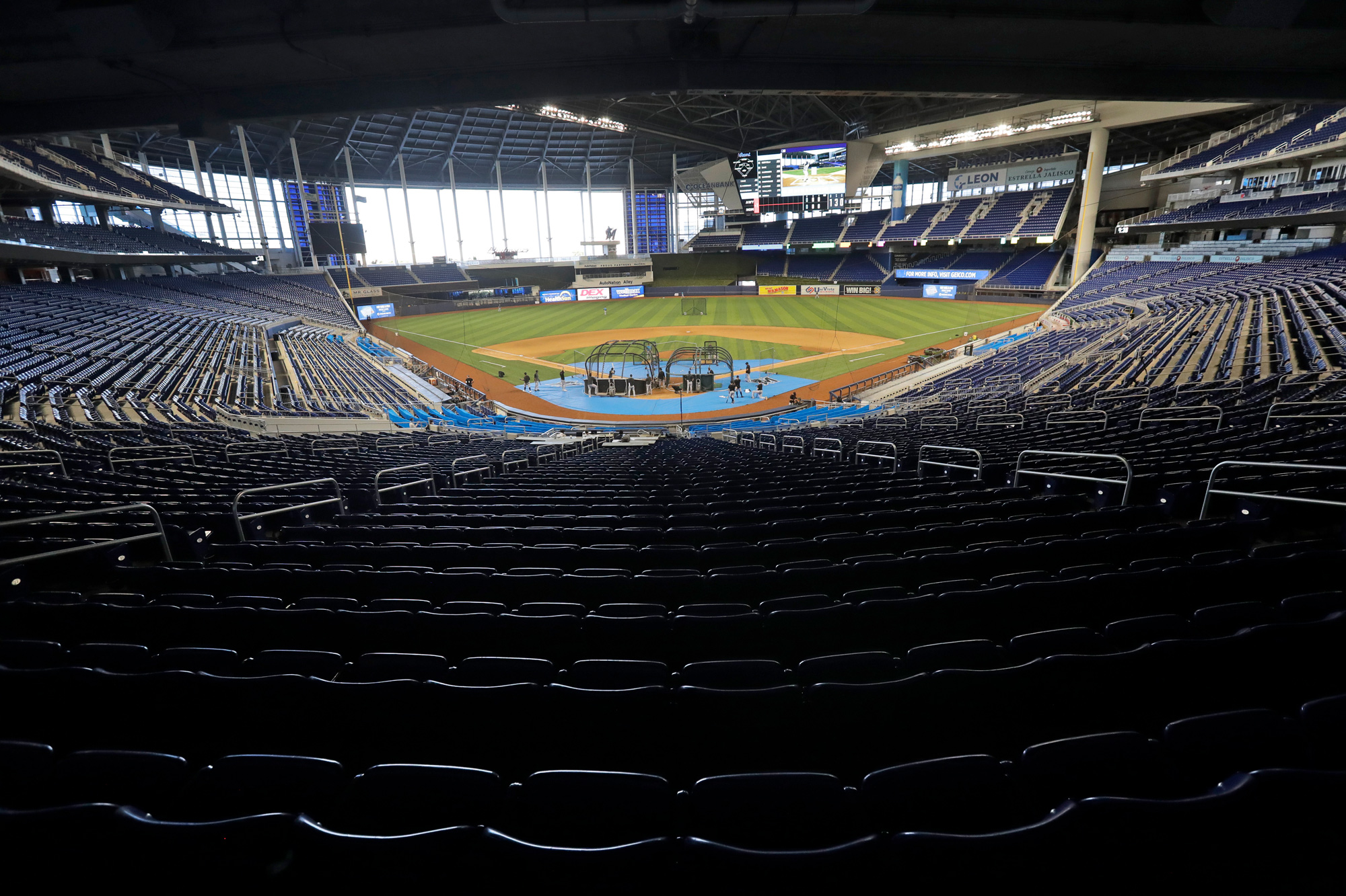 Miami Marlins take batting practice during a baseball workout at Marlins Park on July 16 in Miami.