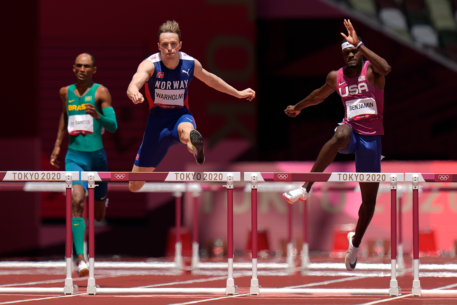 Norway's Karsten Warholm leads in the 400 meters hurdles final on Tuesday.