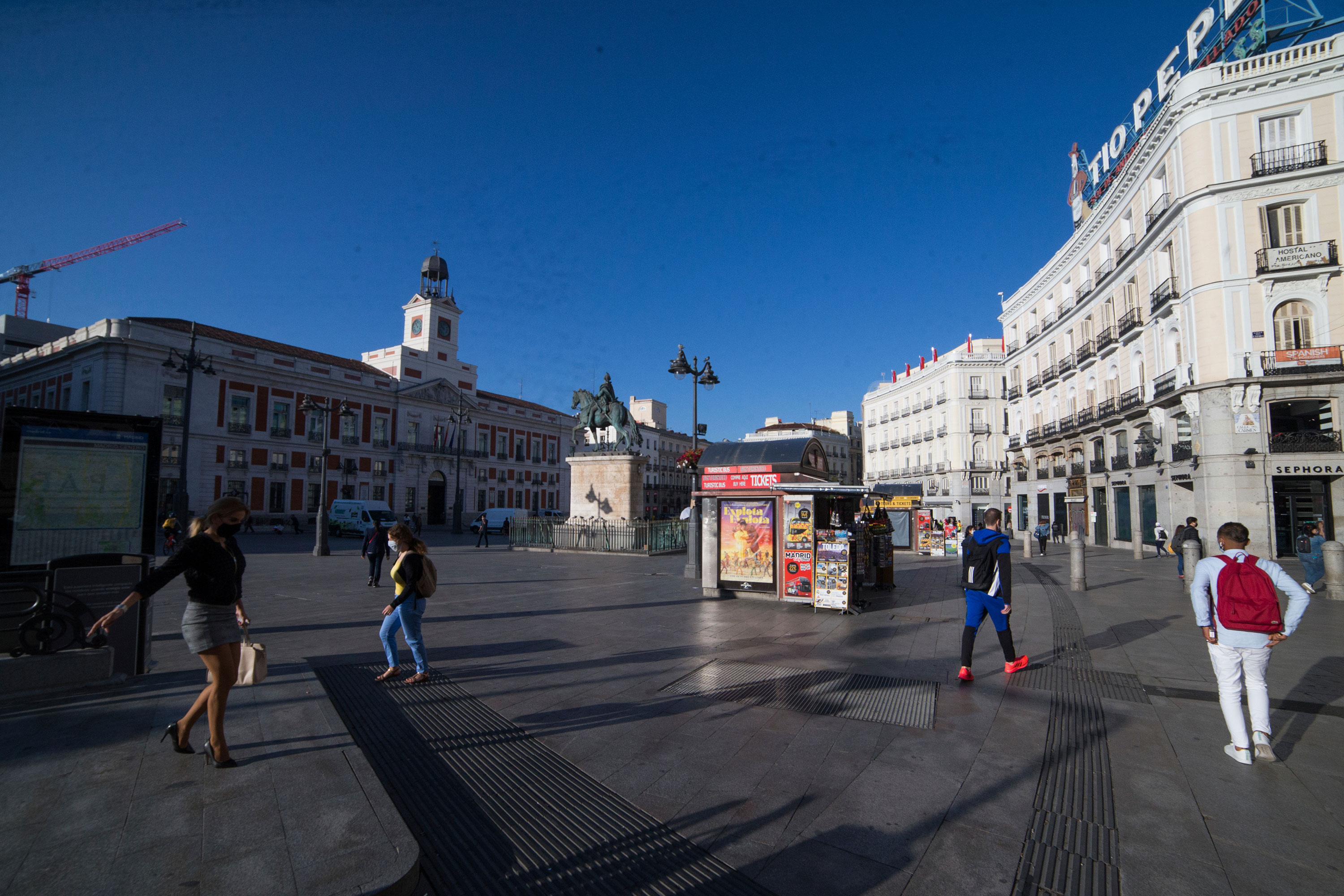 People walk through the Puerta del Sol in Madrid on October 9.