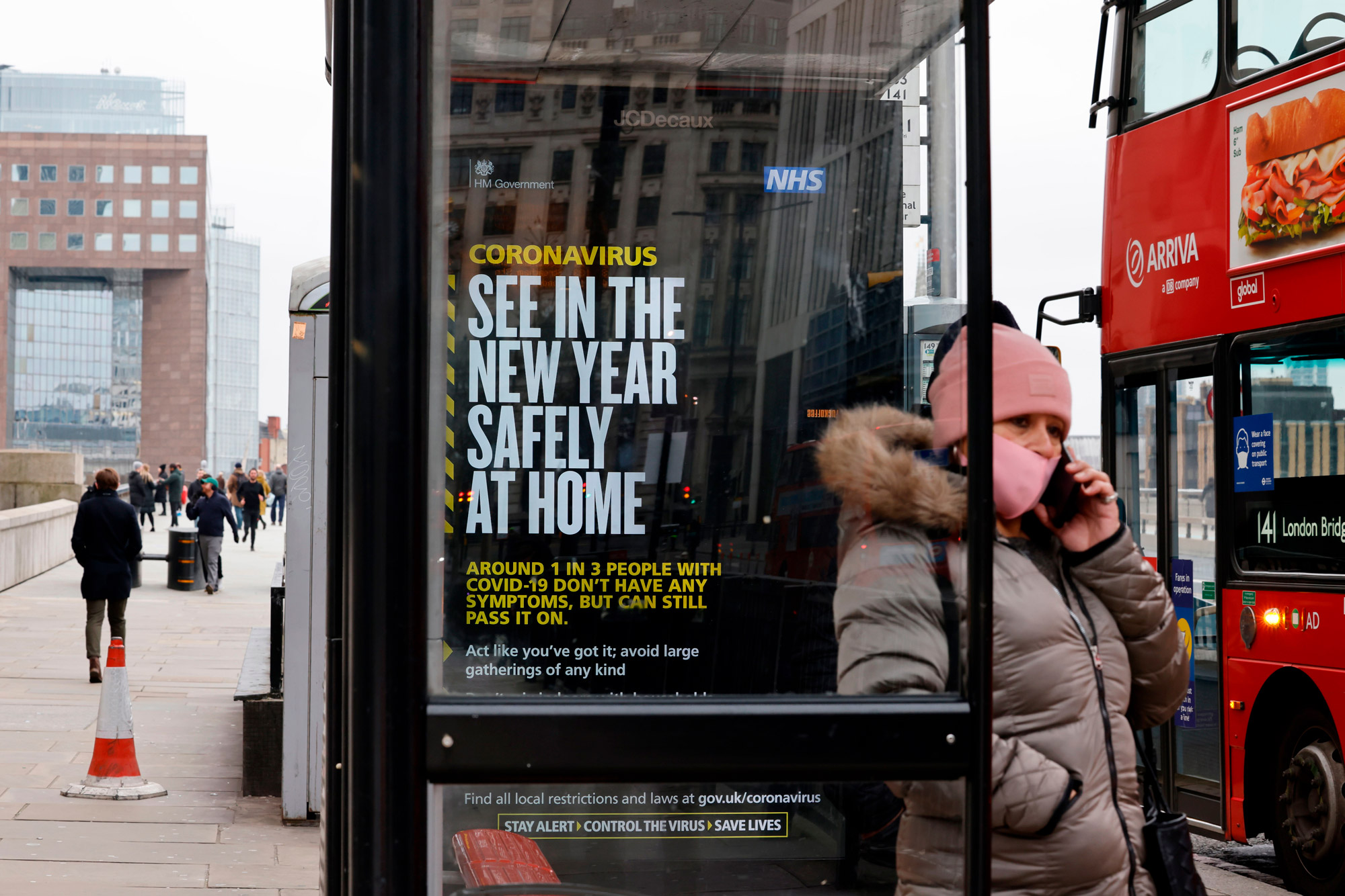 A government message about the coronavirus tier 4 restrictions is seen urging people to stay home in London on December 29.