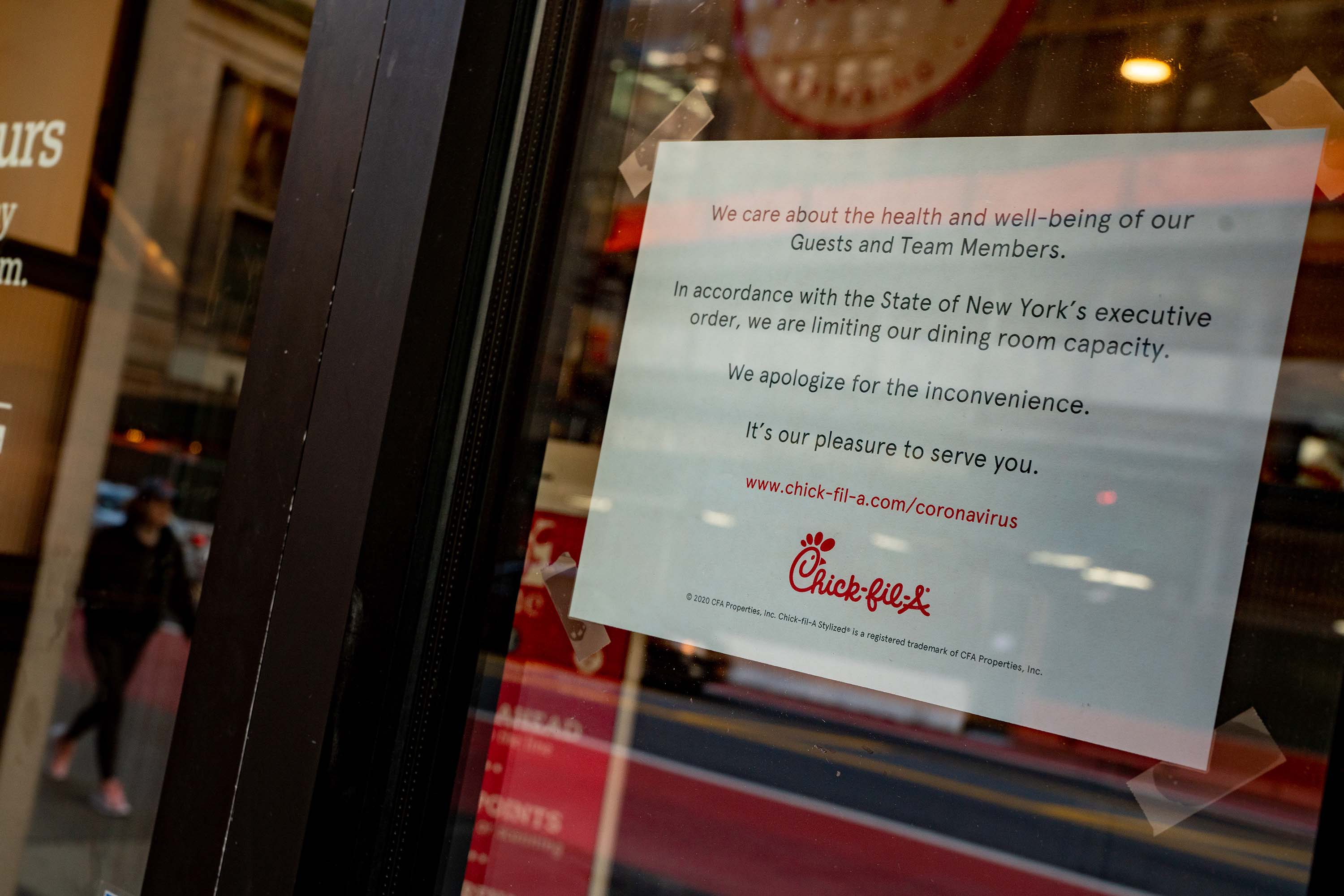 A sign at a Chick-Fil-A in New York informs customers of limited dining room capacity, on March 14.