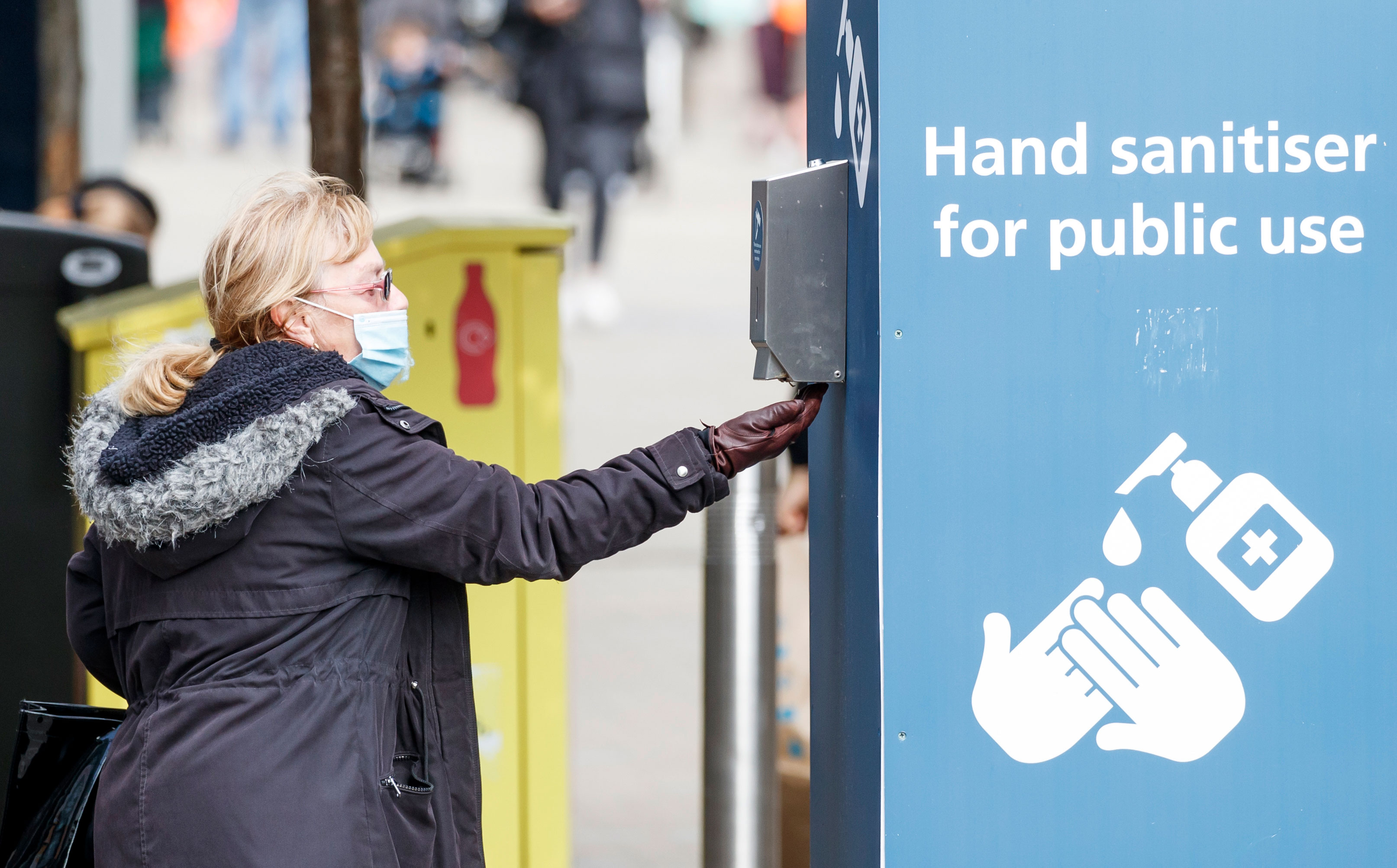 A woman uses hand sanitizer in Leeds, England, on September 11.