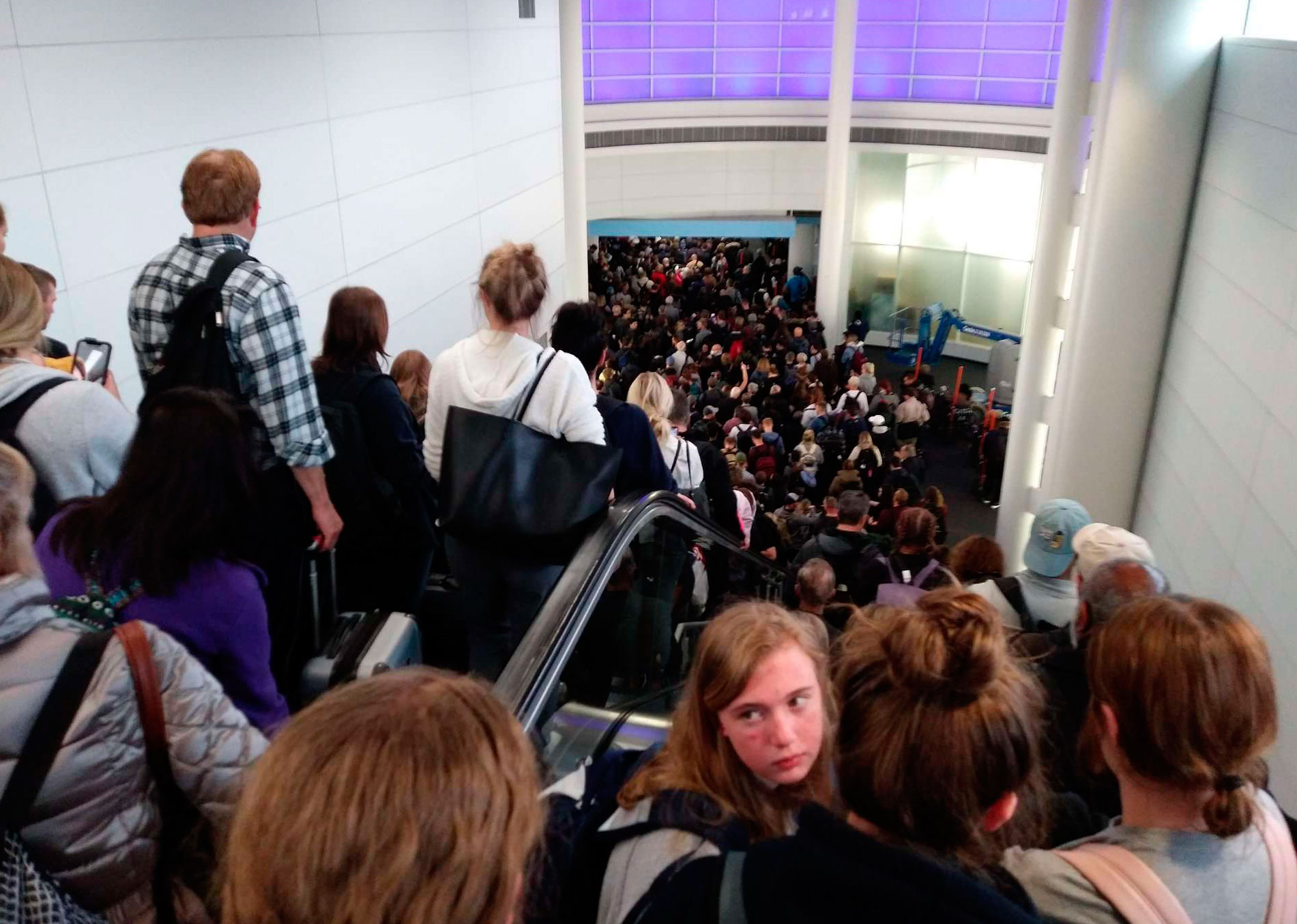 Travelers wait to go through customs at O'Hare International Airport in Chicago on March 15.
