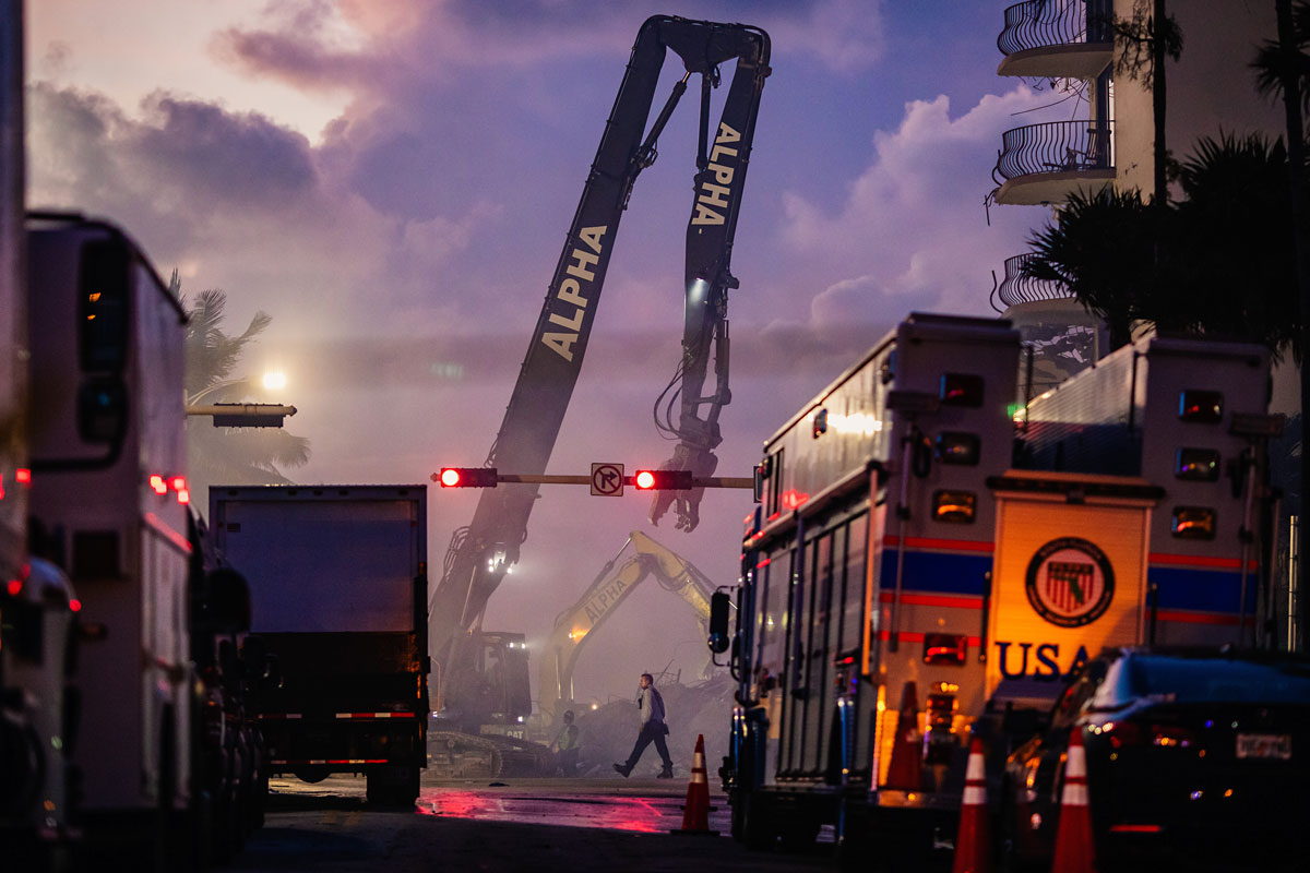 Members of the Miami-Dade Fire Rescue team and excavation crews work to remove debris and search the Champlain Towers South collapse site in Surfside on June 26.