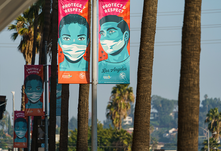 Banners advising people to wear masks against the coronavirus hang along Hollywood Boulevard in Los Angeles on Tuesday, Jan. 5, 2021.
