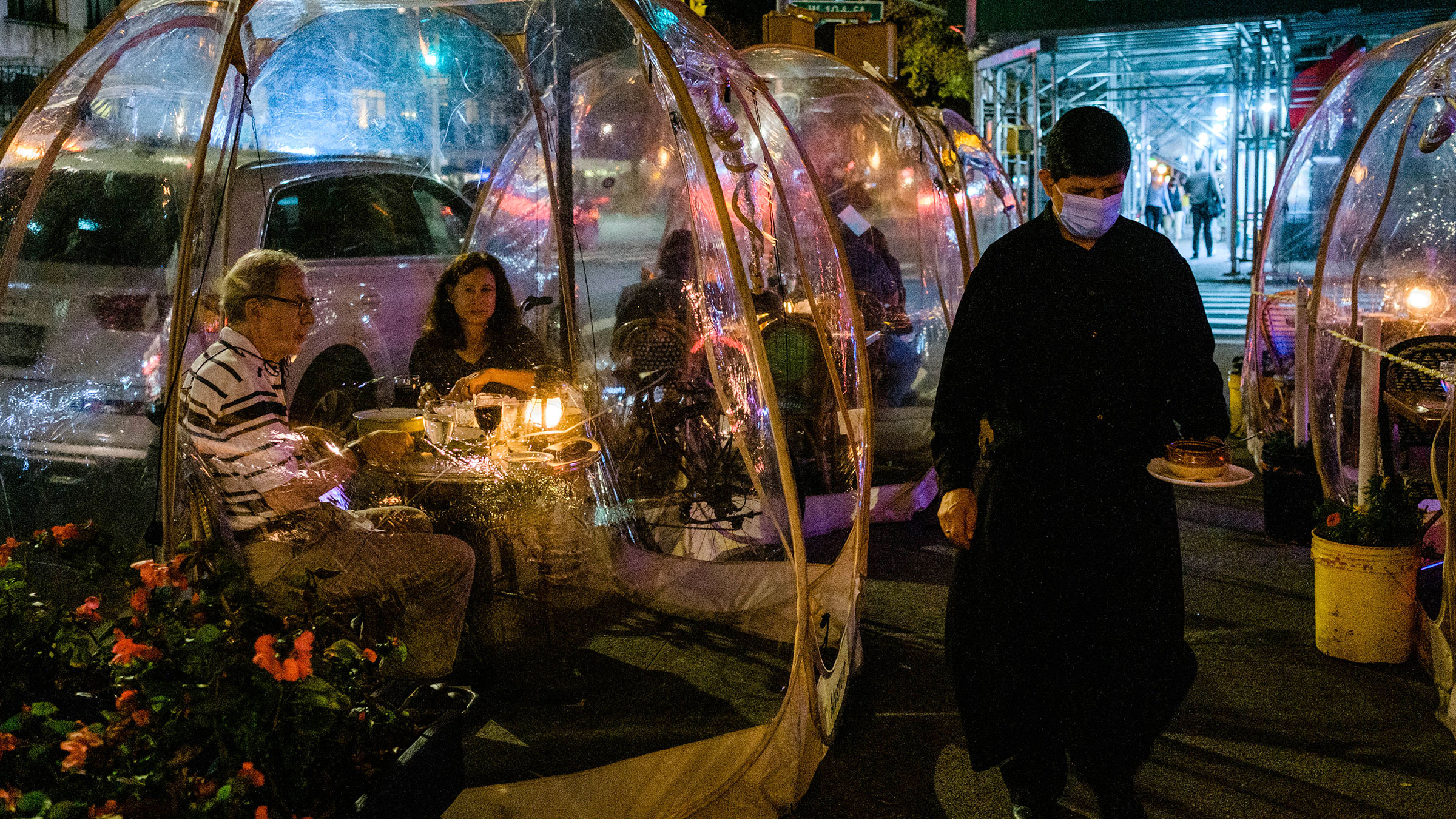 Customers dine in bubble tents at a restaurant in New York on November 10.
