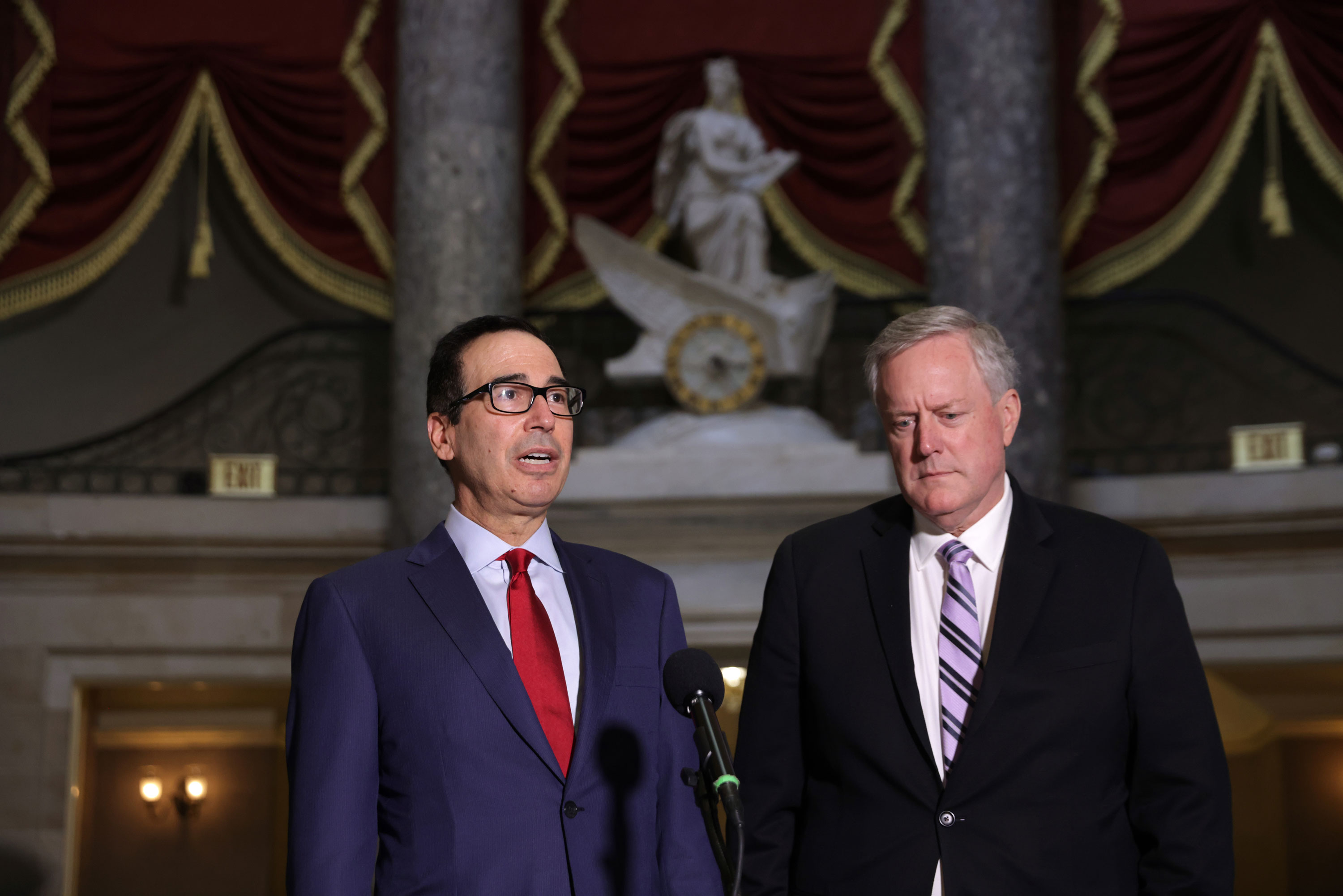 Treasury Secretary Steven Mnuchin, left, and White House chief of staff Mark Meadows speak to the press on August 7 at the Capitol in Washington, DC.