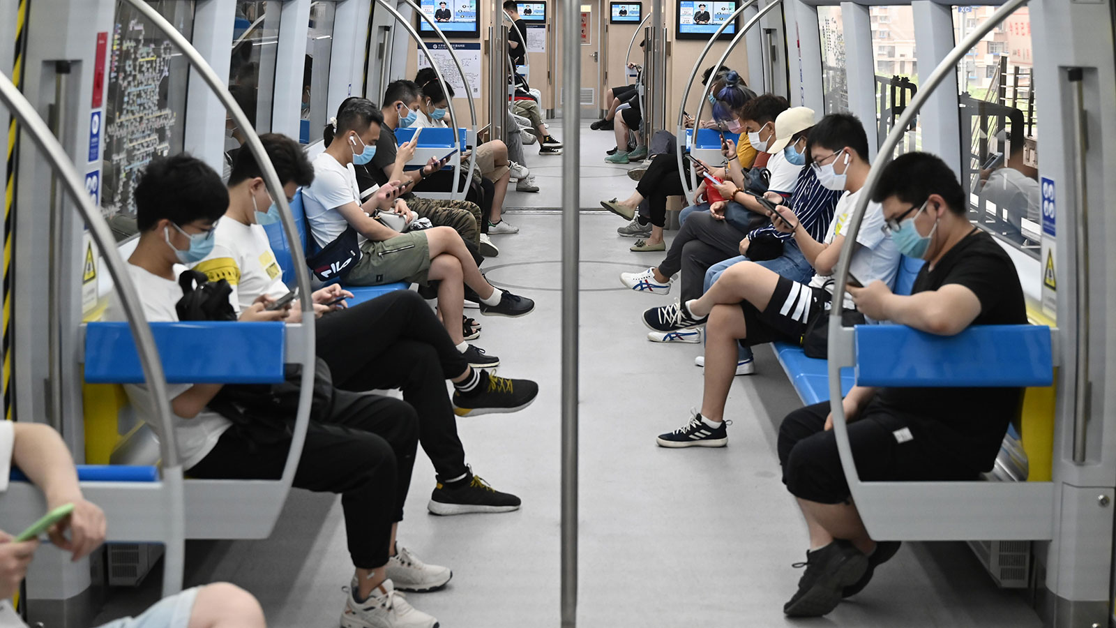 People wearing face masks ride a subway train in Beijing amid the coronavirus outbreak on June 17.