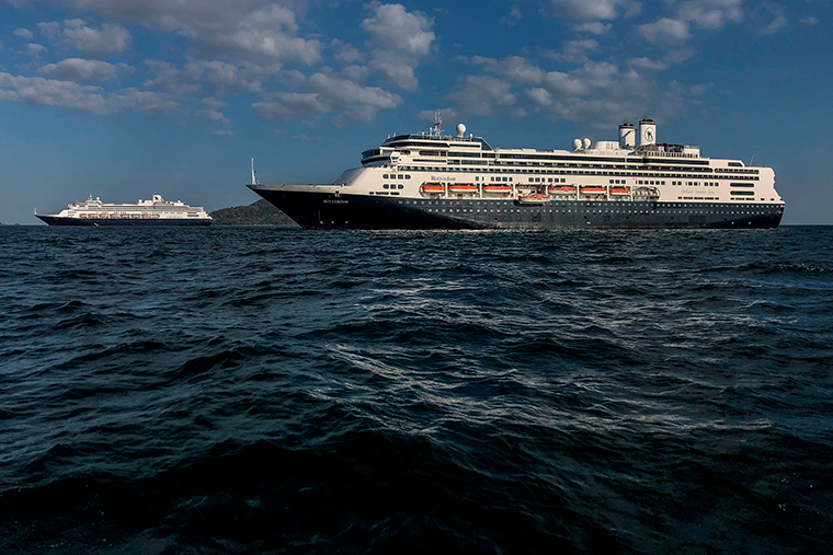 Holland America's cruise ship Zaandam, left, and the Rotterdam cruise ship are seen in Panama City bay on March 28.