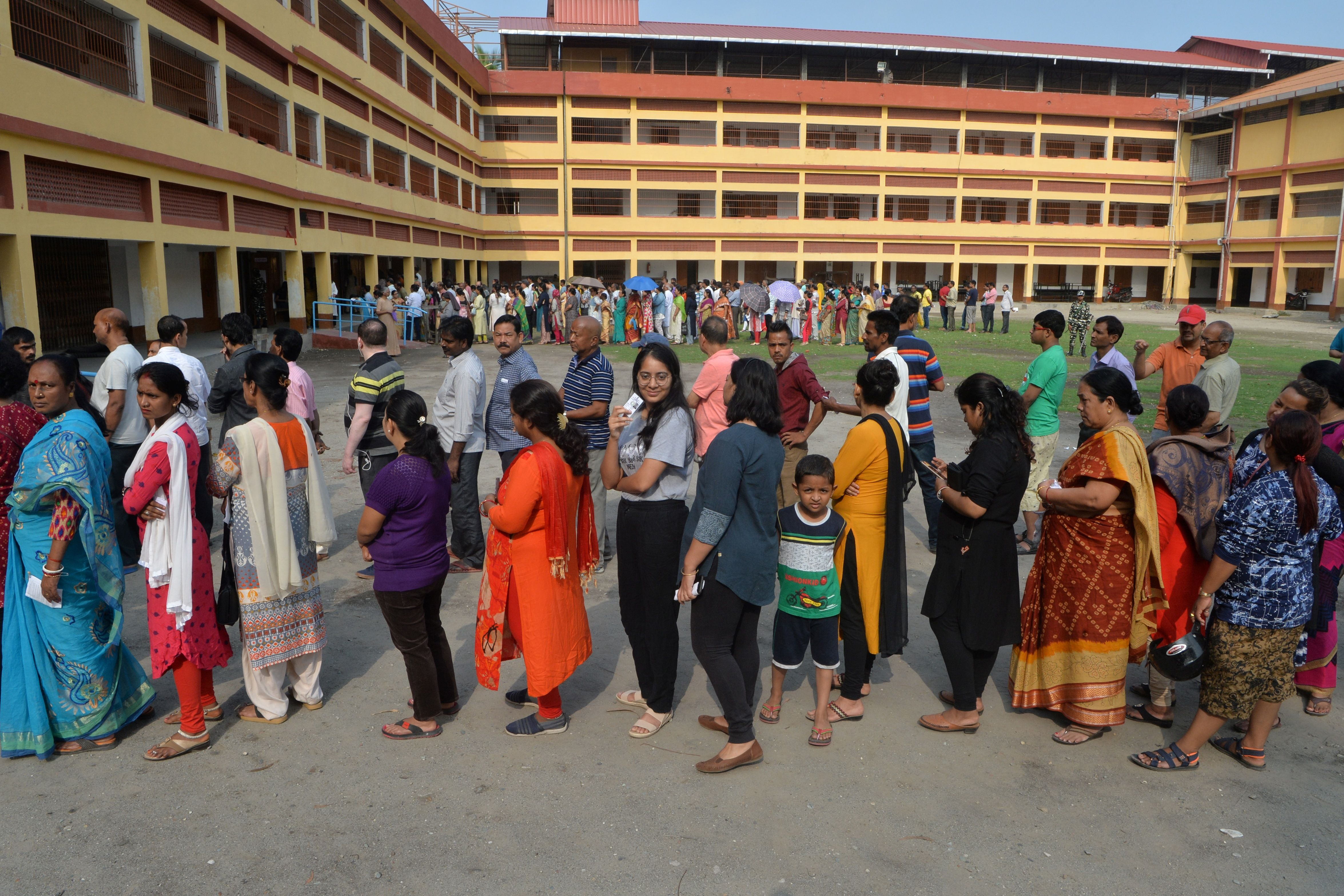 Indian voters queue up to cast their vote at a polling station in Siliguri, West Bengal.