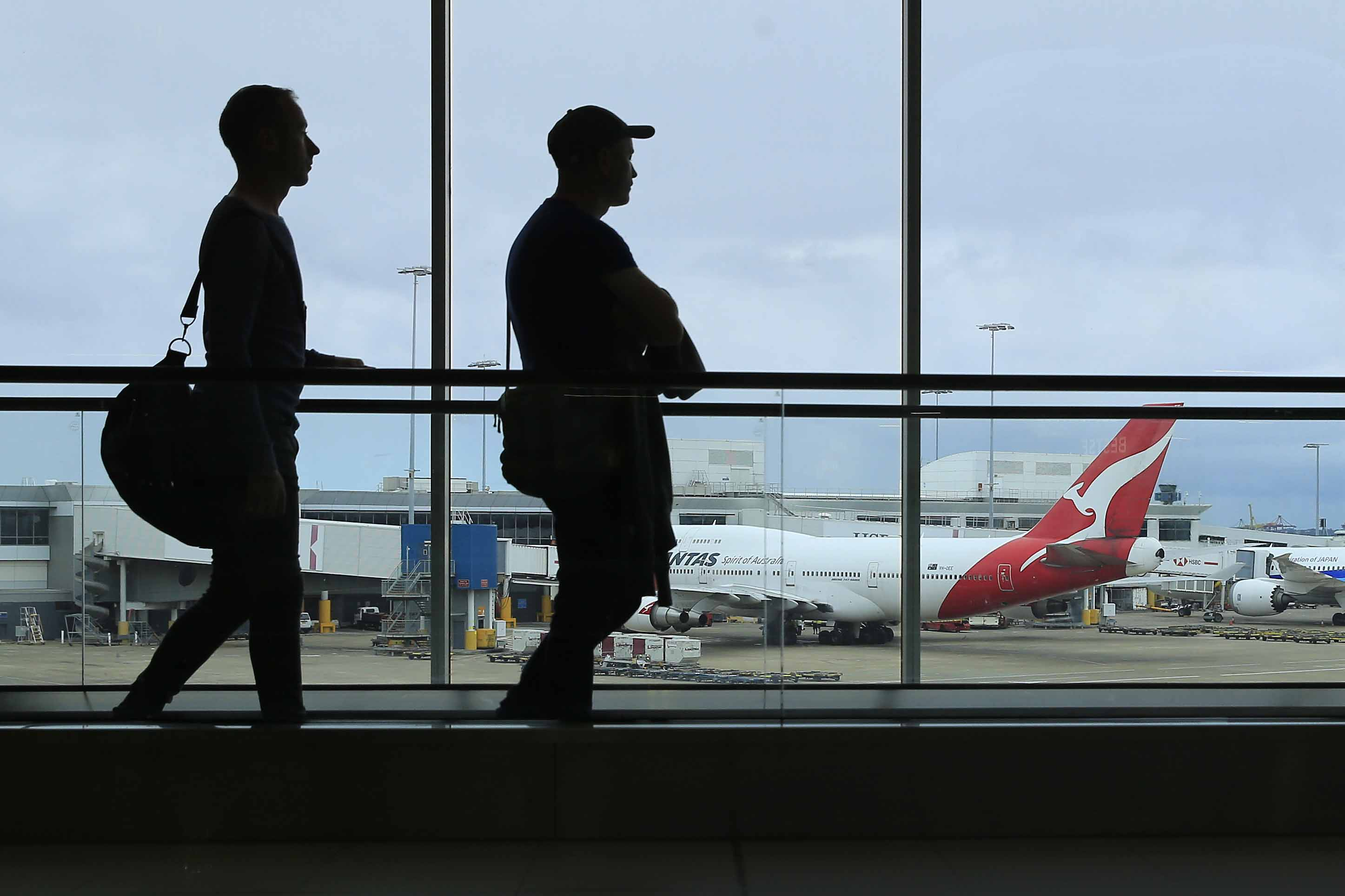 Passengers walk inside the Sydney Airport international terminal on March 10, in Sydney, Australia.