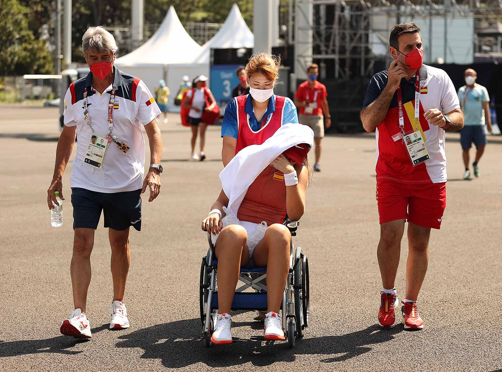 Paula Badosa of Team Spain is helped away from the court in a wheelchair after having to retire from her women's singles quarterfinal match on Wednesday.