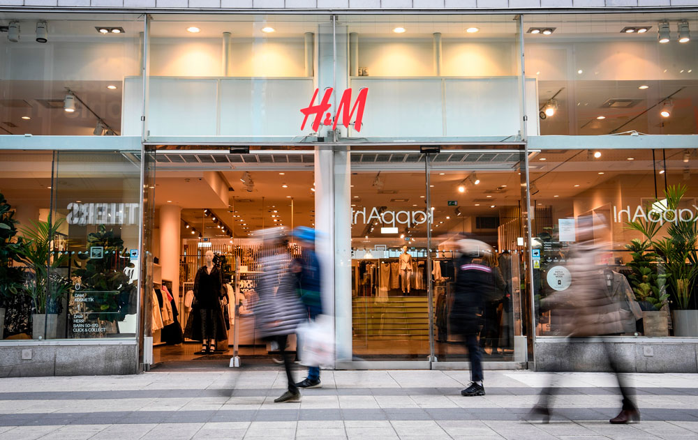 Shoppers walk past an H&M in central Stockholm on April 2.