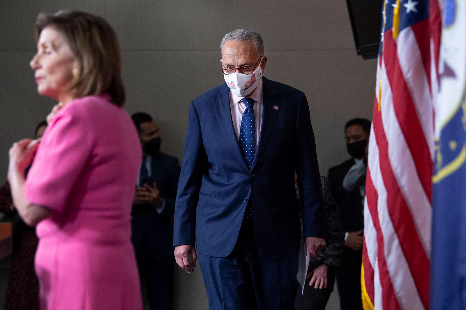 House Speaker Nancy Pelosi, left, and Senate Majority Leader Chuck Schumer arrive for a press conference on September 23.