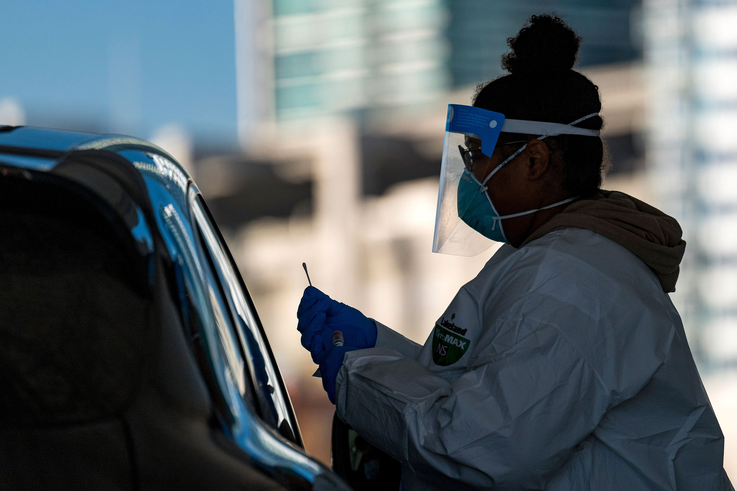 A healthcare worker administers a nasal swab at a Covid-19 testing site in San Francisco, California, on December 1.