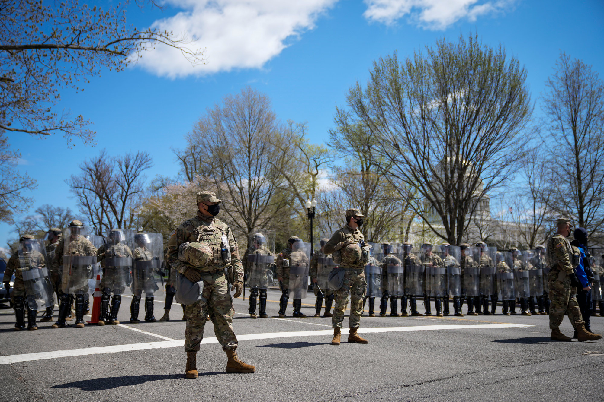 National Guard troops stand guard along Constitution Avenue as law enforcement responds to a security incident near the U.S. Capitol on April 2 in Washington, DC.