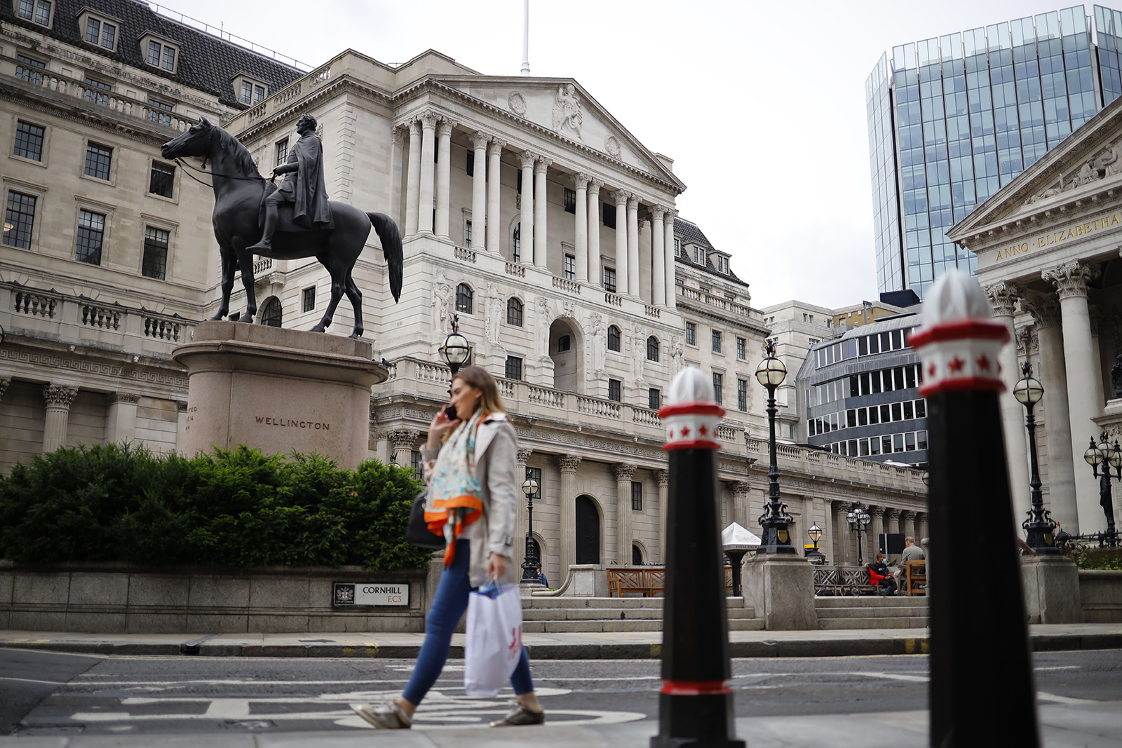 A pedestrian walks past the Bank of England in London on June 17.