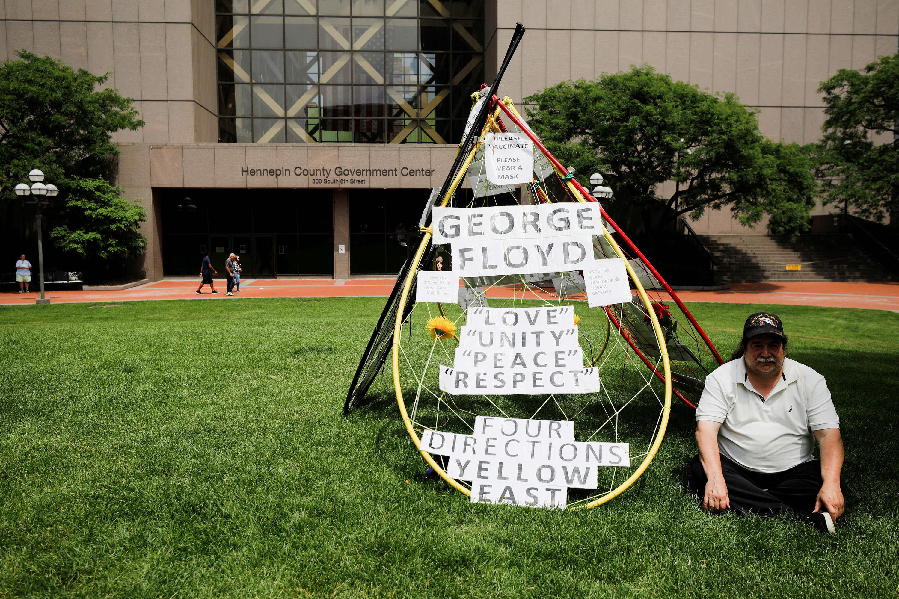 A person waits outside Hennepin County Government Center ahead of Chauvin's sentencing.