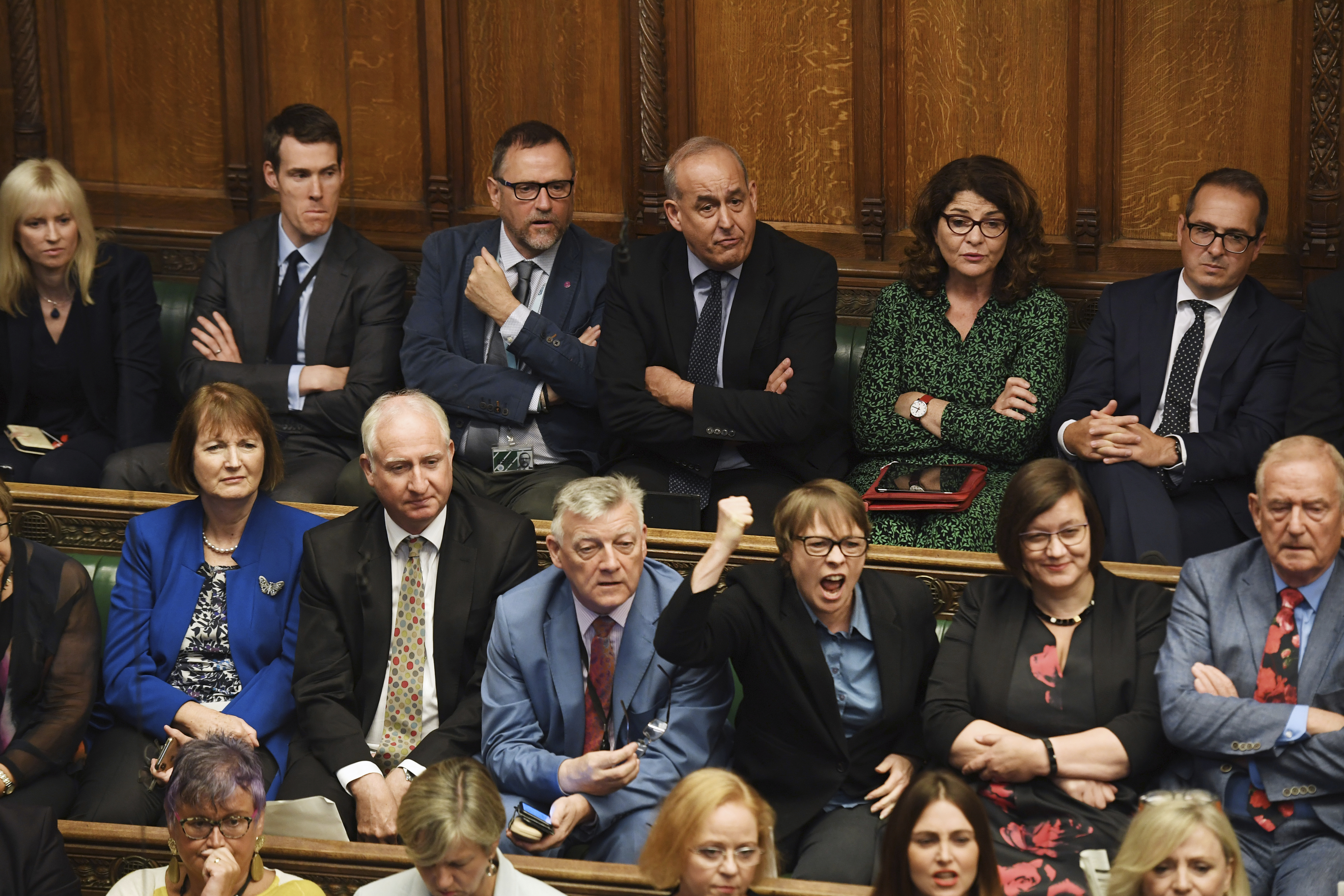 Opposition MPs listen to the Prime Minister.