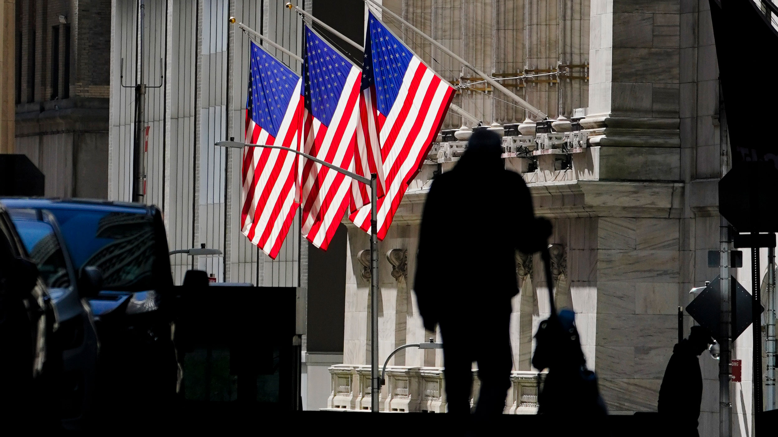 A pedestrian walks past the New York Stock Exchange on October 14.