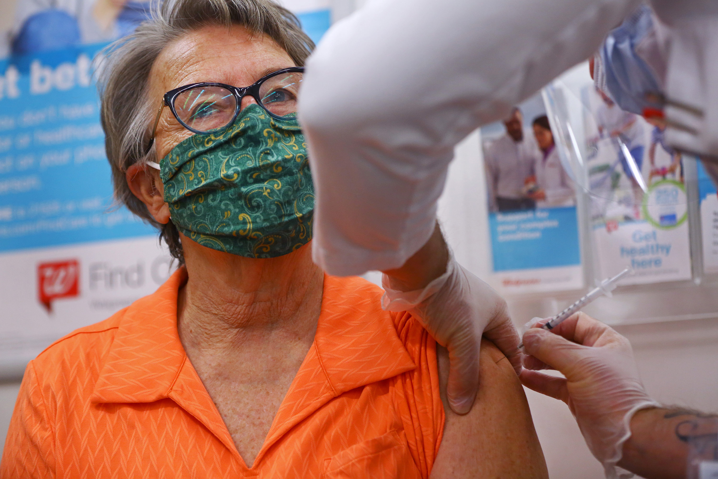A pharmacist administers a Covid-19 vaccine at a Walmart Pharmacy in Danvers, Massachusetts, on February 1.