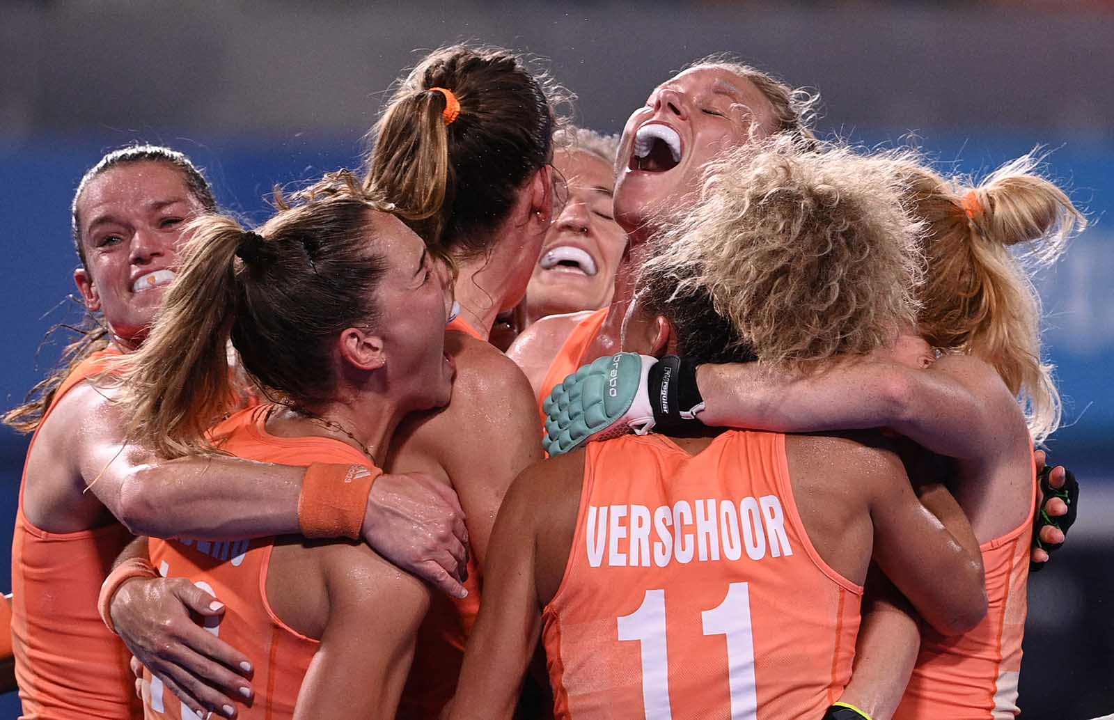 Caia Jacqueline Van Maasakker of the Netherlands, third from right, celebrates with teammates after scoring against Argentina during the women's gold medal field hockey match on August 6.