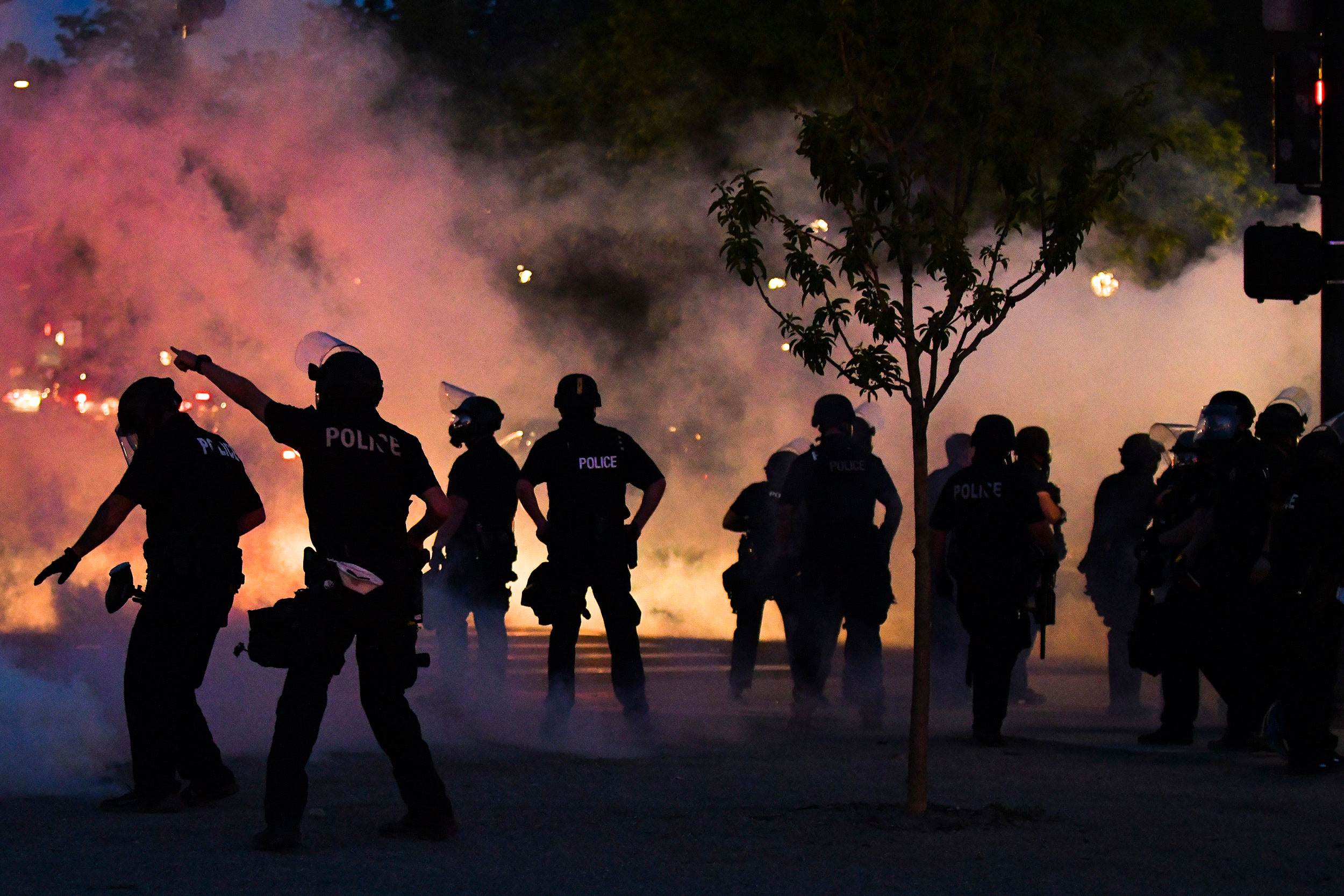 Police officers fire tear gas during a protest on Friday night in Denver, Colorado.