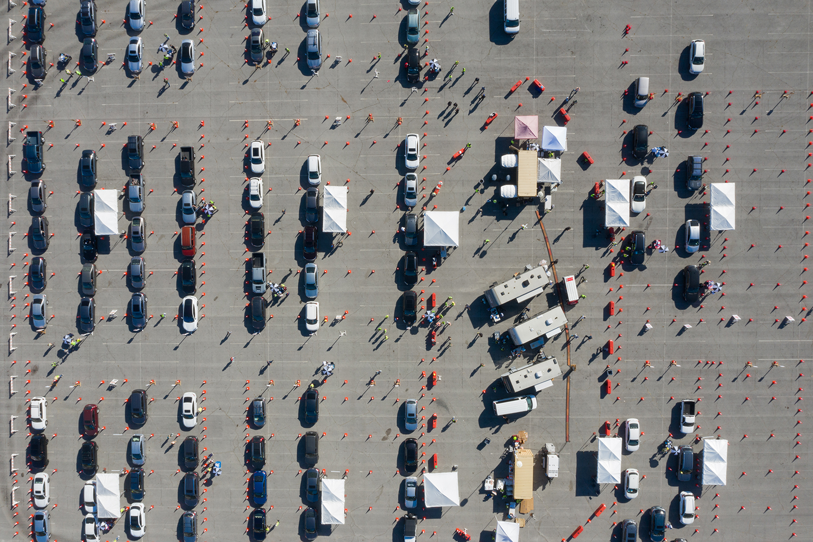 People wait in vehicles at a Covid-19 vaccination site in the Dodger Stadium parking lot in Los Angeles, on January 15.