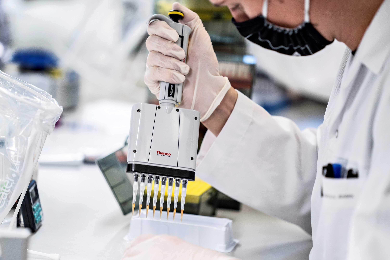 A researcher at Aalborg University analyzes positive Danish coronavirus samples to screen for the UK variant in Aalborg, Denmark on January 15.