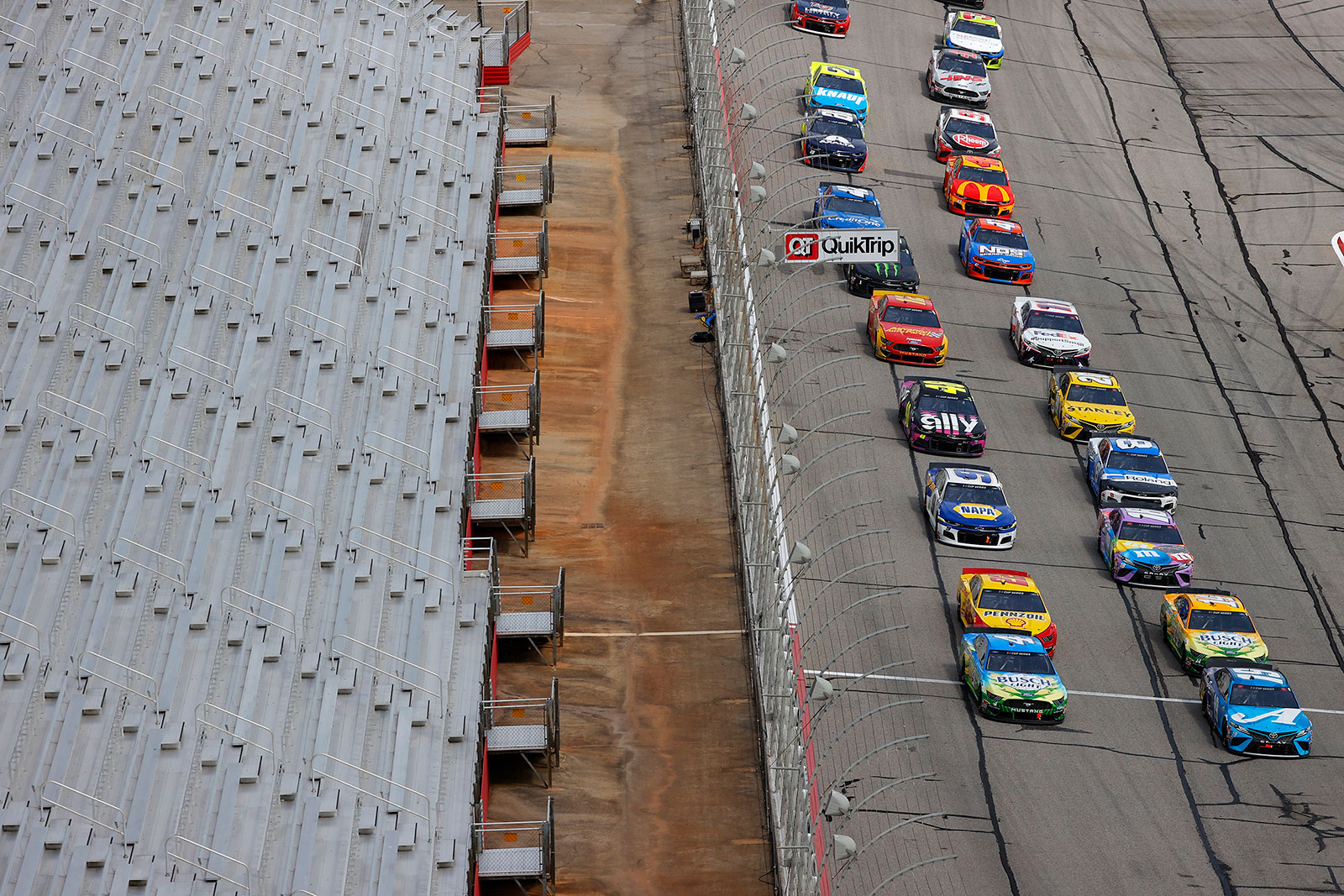 Drivers race during the NASCAR Cup Series Folds of Honor QuikTrip 500 at Atlanta Motor Speedway on June 7. NASCAR has been conducting races without fans since May 17.