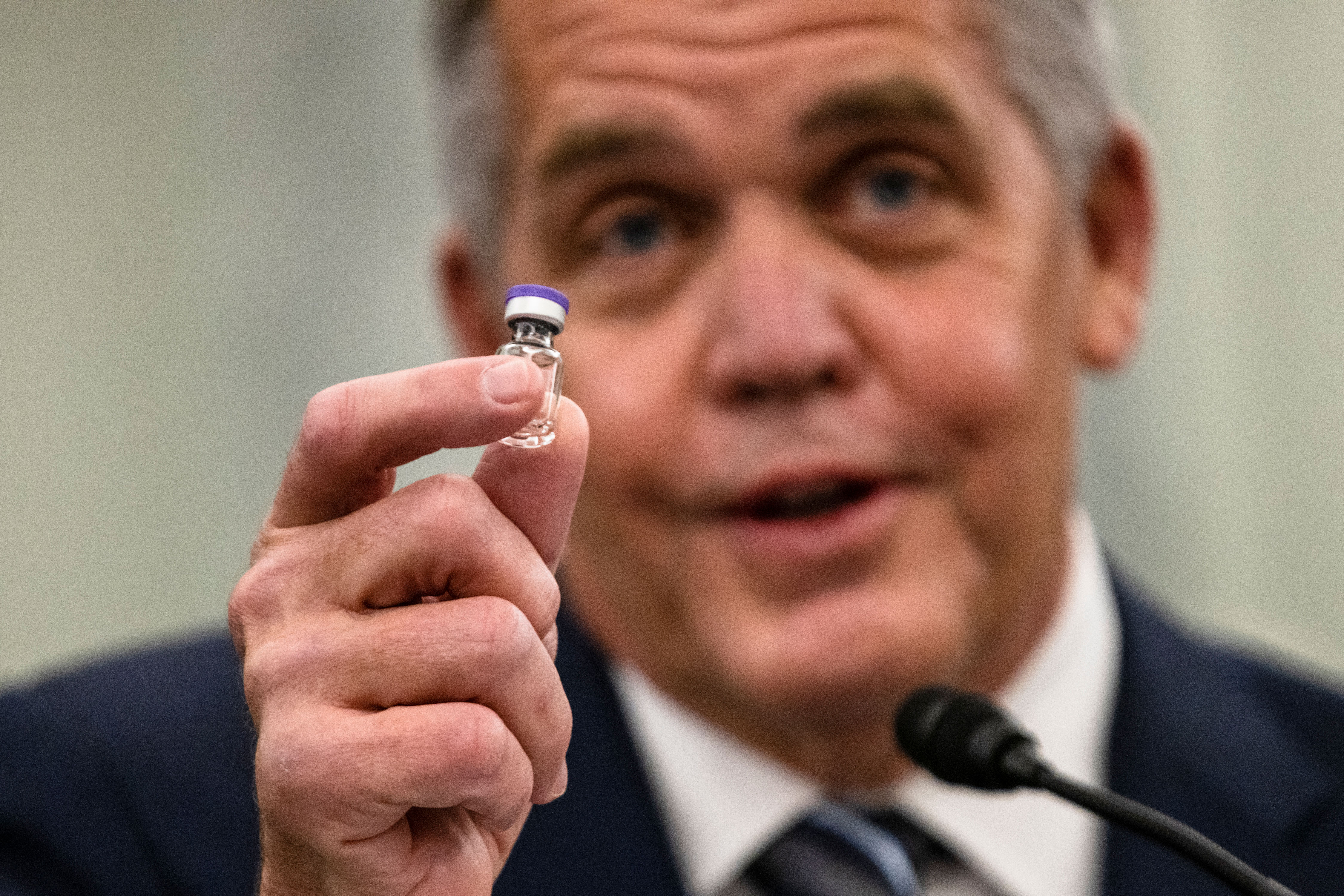 UPS President of Global Healthcare Wesley Wheeler holds an example of the vial that will be used to transport the Pfizer COVID-19 vaccine as he speaks on Capitol Hill, on Thursday, December 10.