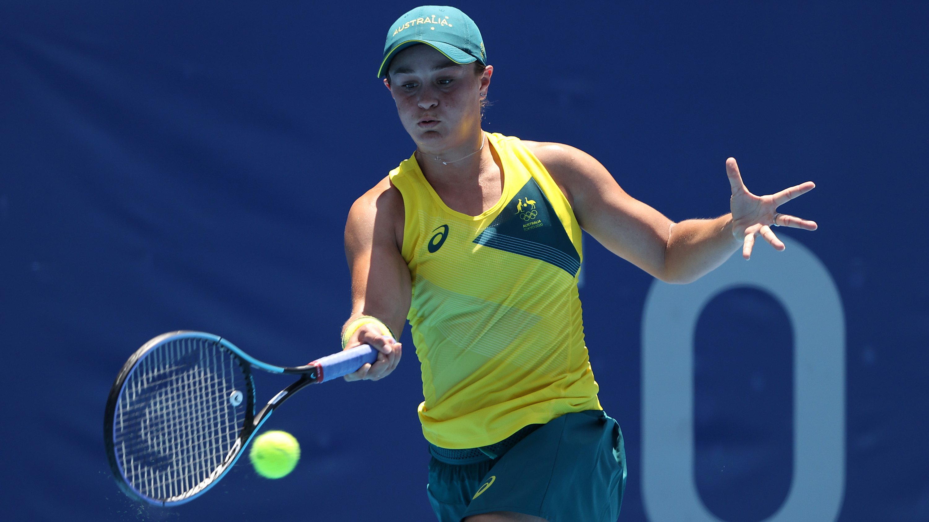 Ashleigh Barty of Team Australia plays a forehand during her Women's Singles First Round match on July 25.