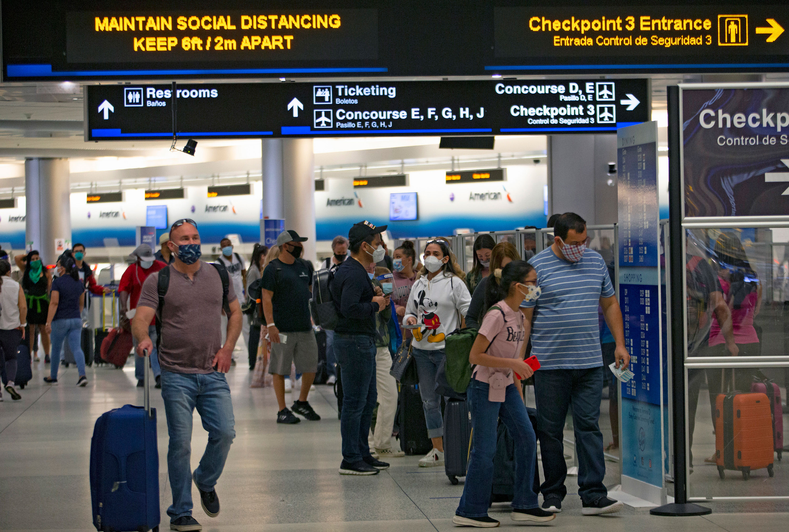 Travelers walk in Florida's Miami International Airport on November 22.