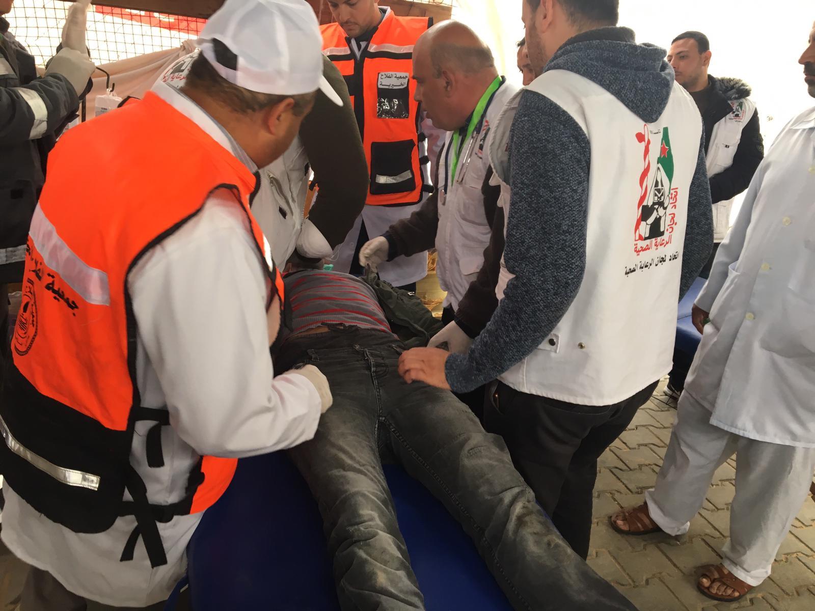 A man is treated for tear gas inhalation in Jabalya, Gaza.