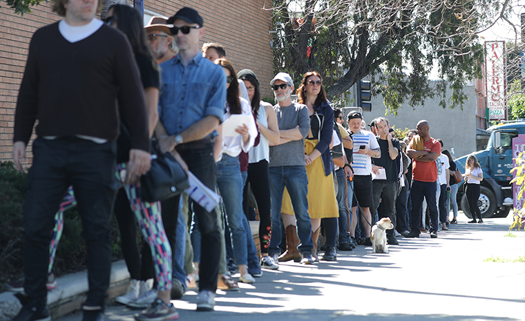 Voters wait in line to cast their ballots at a vote center at a Masonic Lodge on Tuesday, March 3, in Los Angeles.