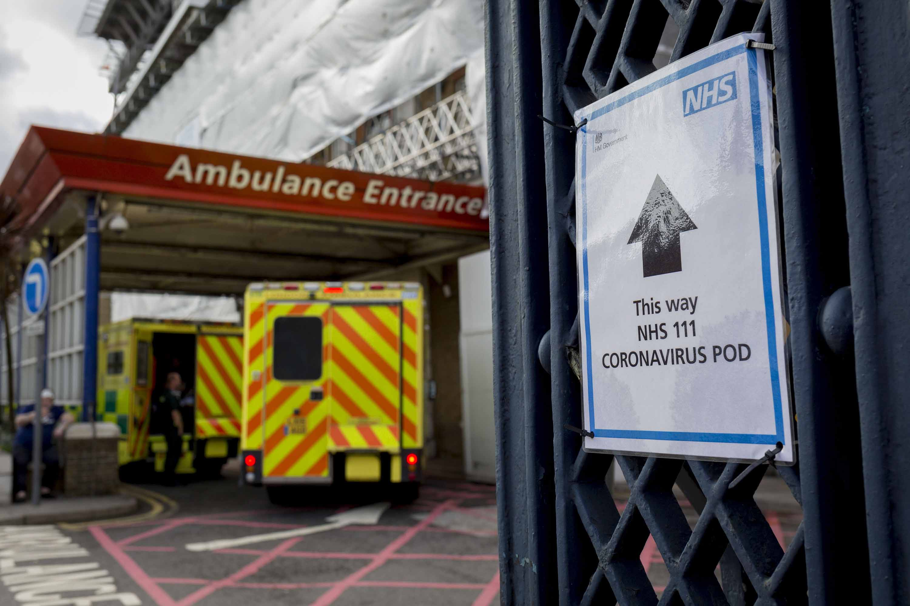 An NHS sign points towards a coronavirus testing pod at Kings College Hospital in Camberwell, south London, on March 11.