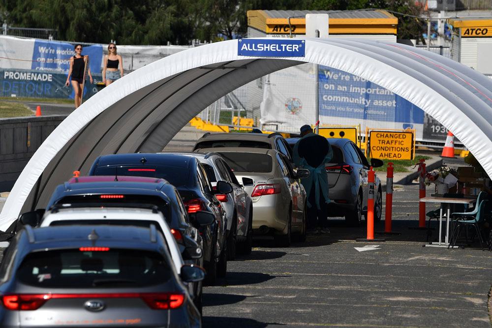 Cars queue up for free drive-through coronavirus tests at Bondi Beach in Sydney on April 22.