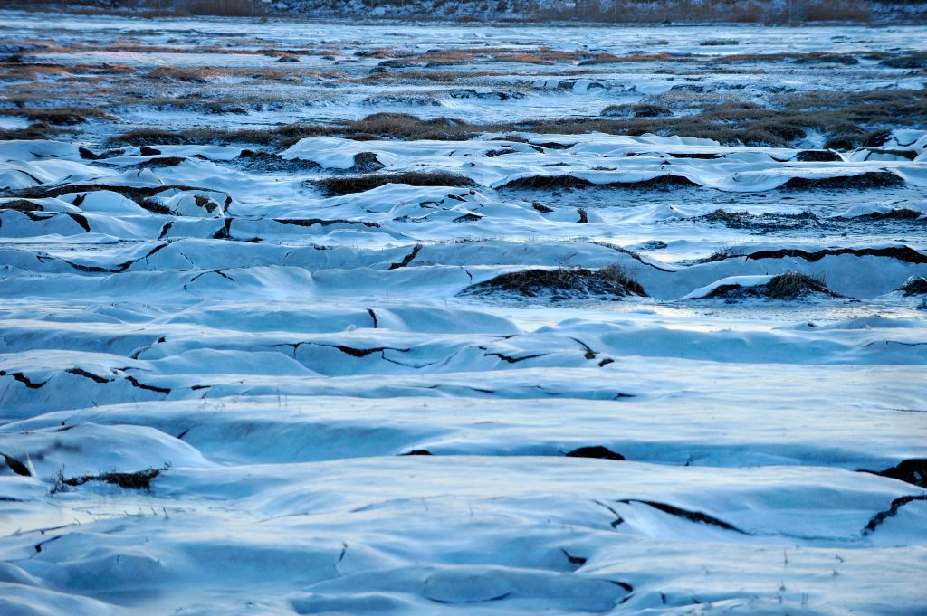 The marsh around Logan Airport in Boston remains frozen Thursday due to extreme cold and ice conditions.