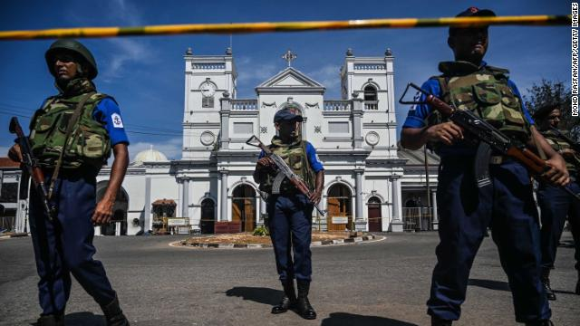 Security personnel stand guard outside St. Anthony's Shrine in Colombo on Monday, a day after the church was hit in series of bomb blasts targeting churches and luxury hotels in Sri Lanka.