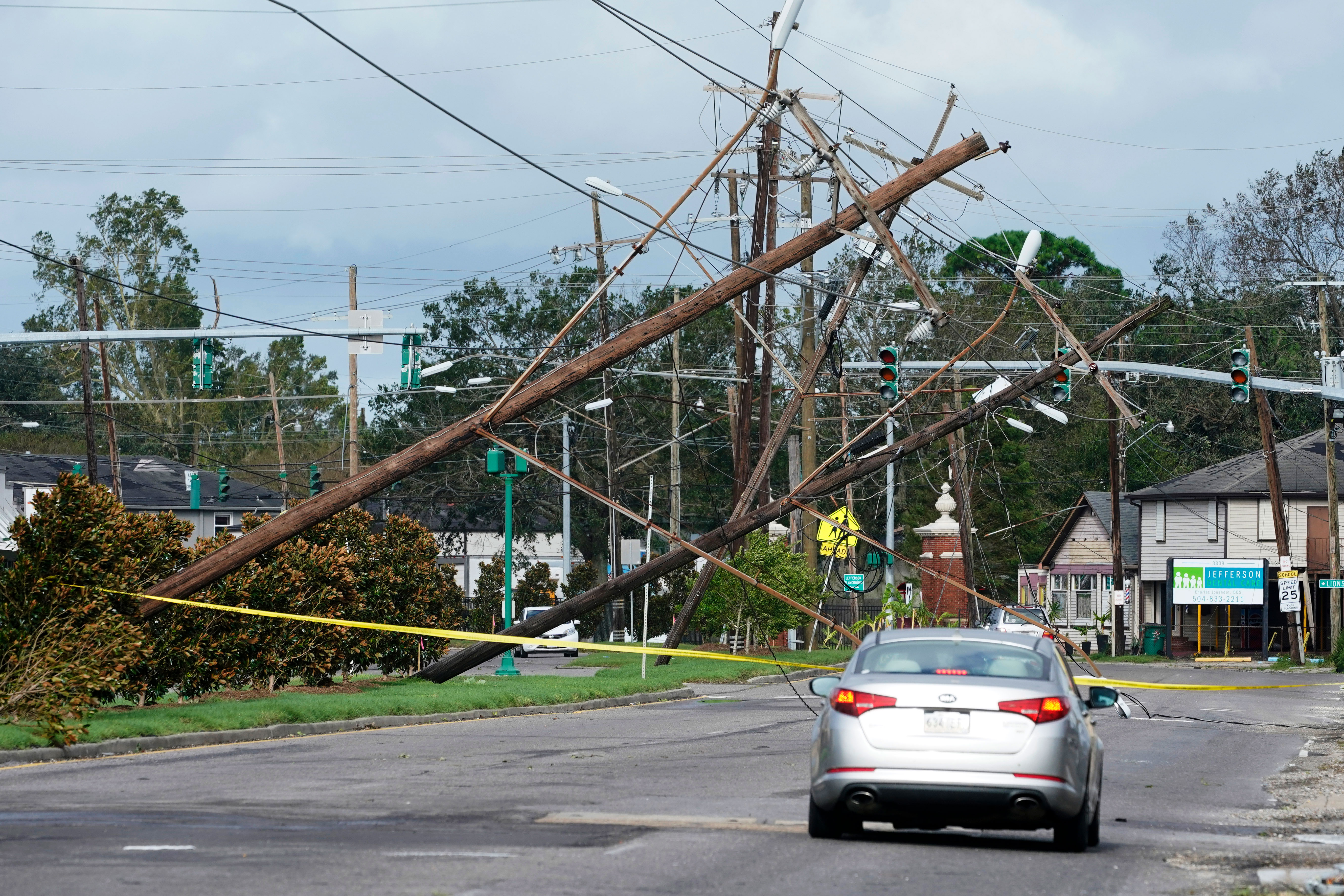 Downed power lines are seen in Metairie, Louisiana, on August 30.