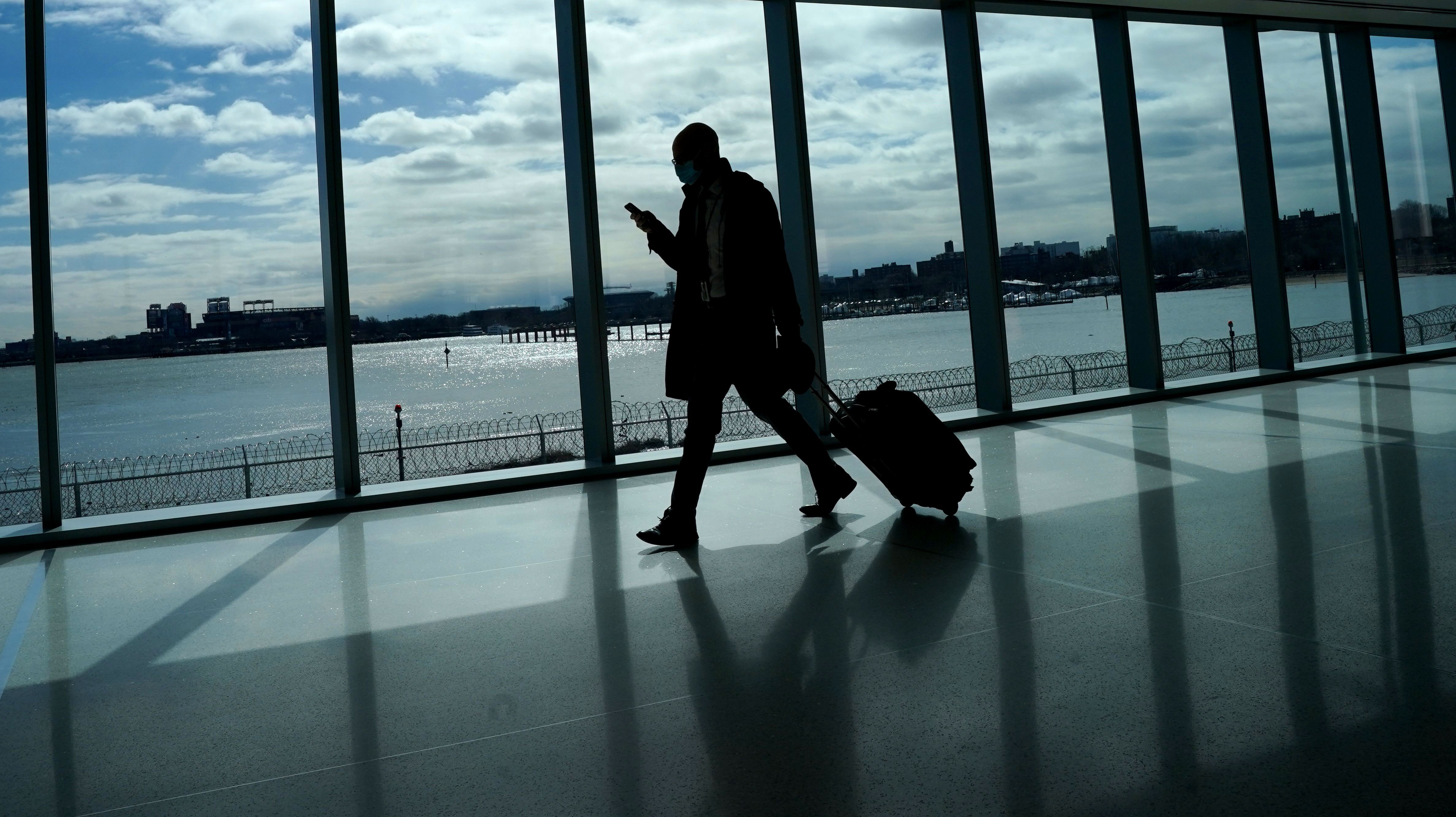 A person walks through LaGuardia Airport in Queens, New York, on March 6.