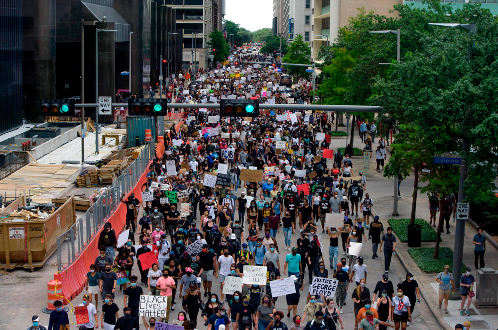 Protesters march during a demonstration over the death of George Floyd in Houston on May 29.